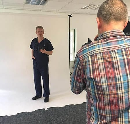 Scrub suit garments being photographed