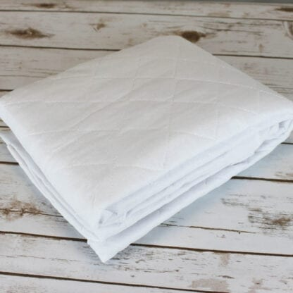 Cot size quilted mattress protector